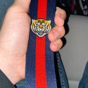Gucci belt red, navy blue, and tiger face print.